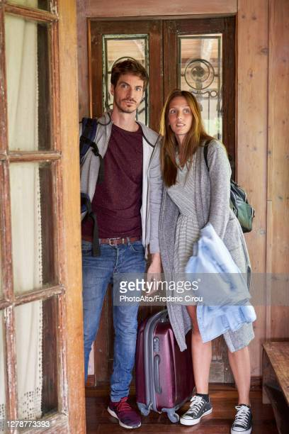 young couple entering their new house - entering stock pictures, royalty-free photos & images