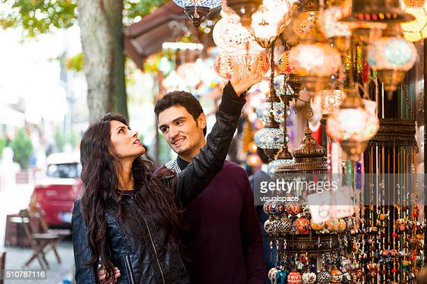 Young Couple Examining Goods in Street Market