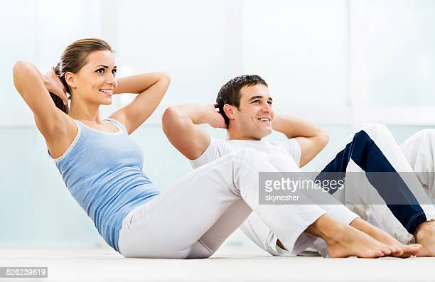 Young couple exercising.