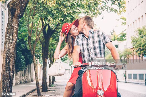 Young Couple Exploring the City on a Vintage Scooter