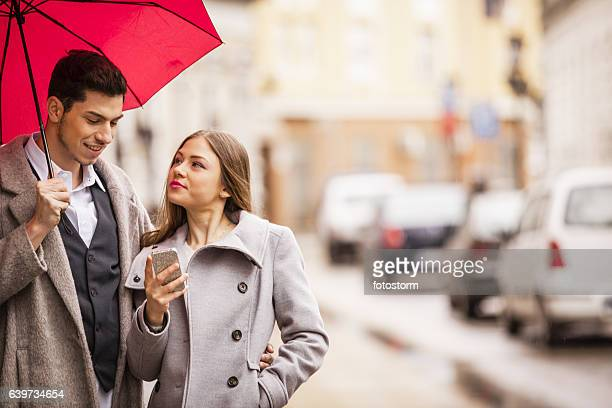 Young couple exploring the city using a mobile app