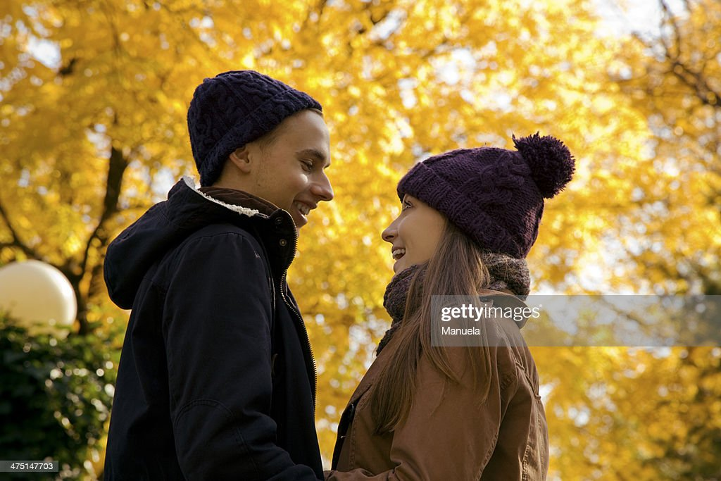 Young couple face to face in autumn park, Vienna, Austria : Stock Photo
