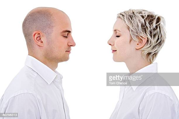 Young couple with eyes closed, side view, close-up