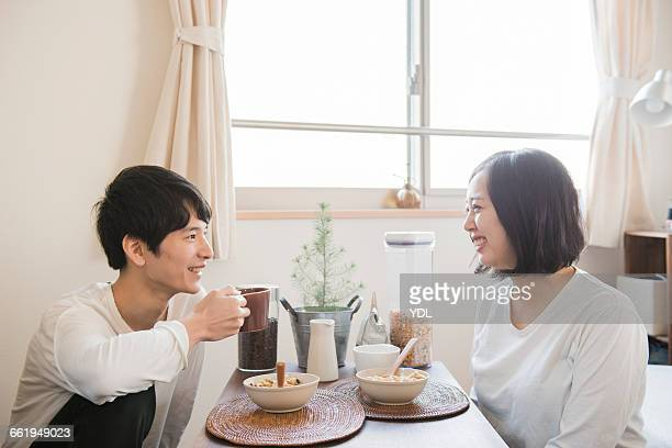 Young couple faces and talks smiley.
