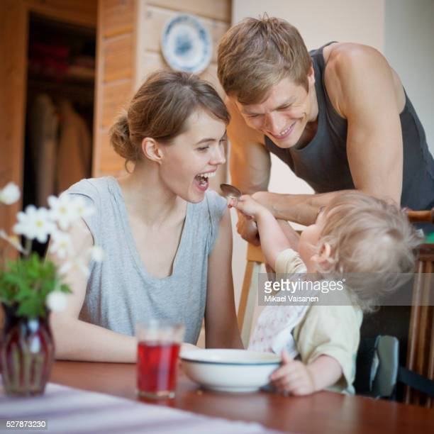 young couple feeding little boy (12-23 months) - 12 23 months stock pictures, royalty-free photos & images