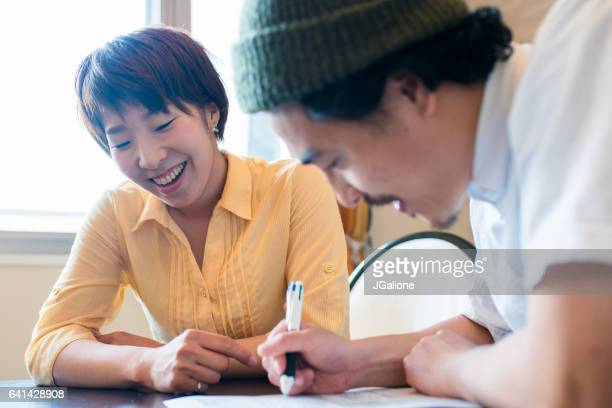 Young couple filling out paperwork