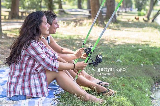 young couple fishing at lake - pjphoto69 bildbanksfoton och bilder
