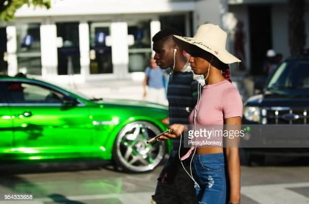 Young Couple Flashy Car Ocean Drive in South Beach Miami