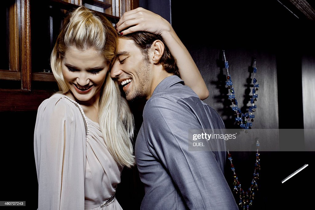Young couple flirting in nightclub : Stock Photo