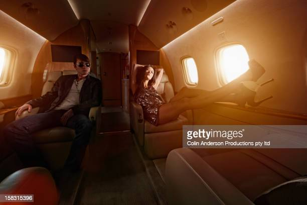 Young couple flying on private jet