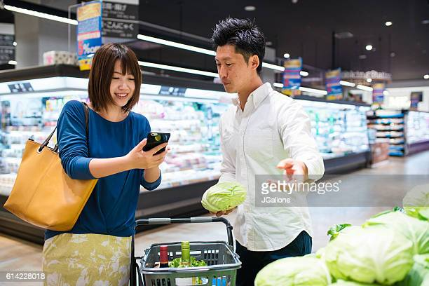 Young couple food shopping together