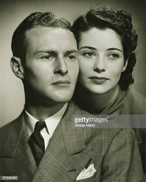 young couple, formal portrait in studio, (b&w), close-up - permed hair stock photos and pictures