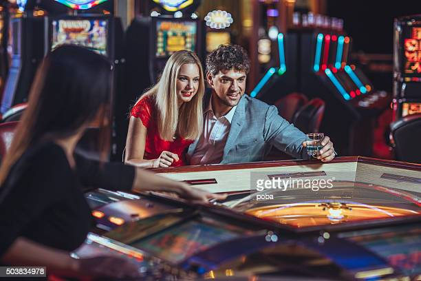 Young couple gambling at the casino