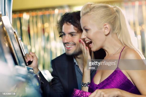 young couple gambling in the casino