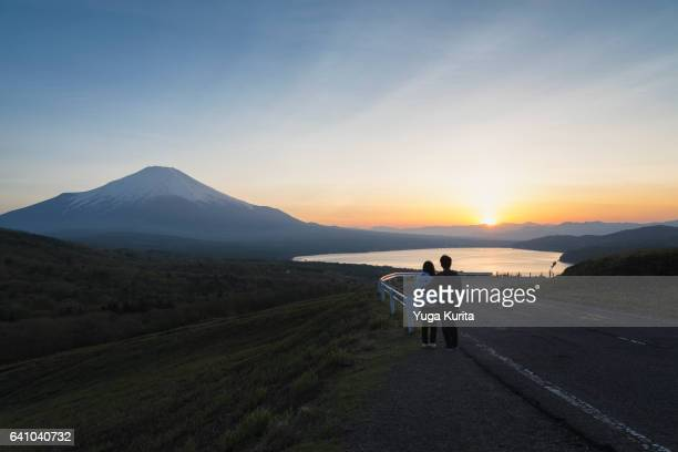 A Young Couple Gazing at Mount Fuji and Sunset from Mikuni Pass