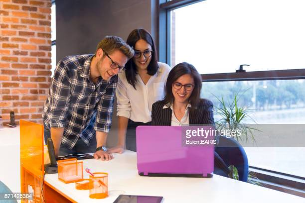 Young couple getting advice in office from beautiful business woman