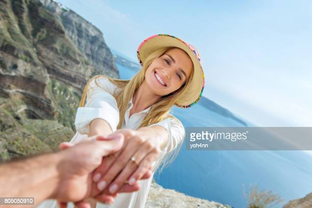 young couple getting engaged - man holding engagement ring stock photos and pictures