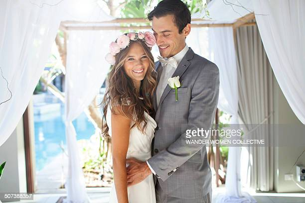 young couple getting married at wedding alter - bride stock pictures, royalty-free photos & images