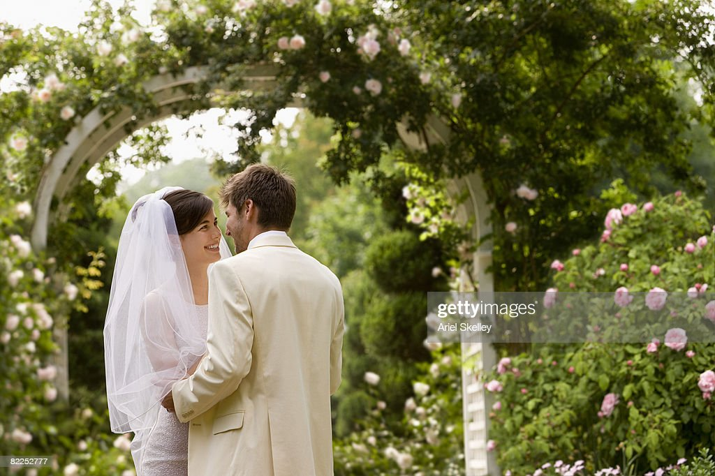 Young Couple Getting Married in Garden : Stock Photo