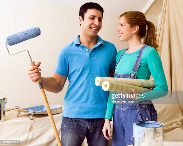 Young couple getting ready for home remodeling.