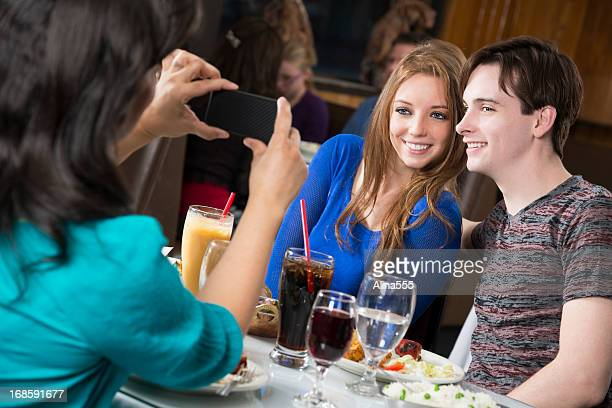 Young couple getting their picture taken in the restaurant