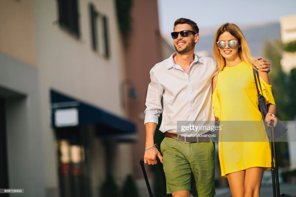 Young couple going on a vacation : Stock Photo
