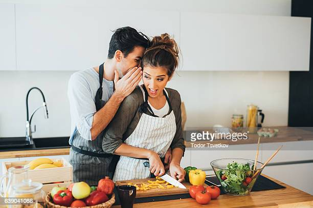 Young couple gossip in the kitchen