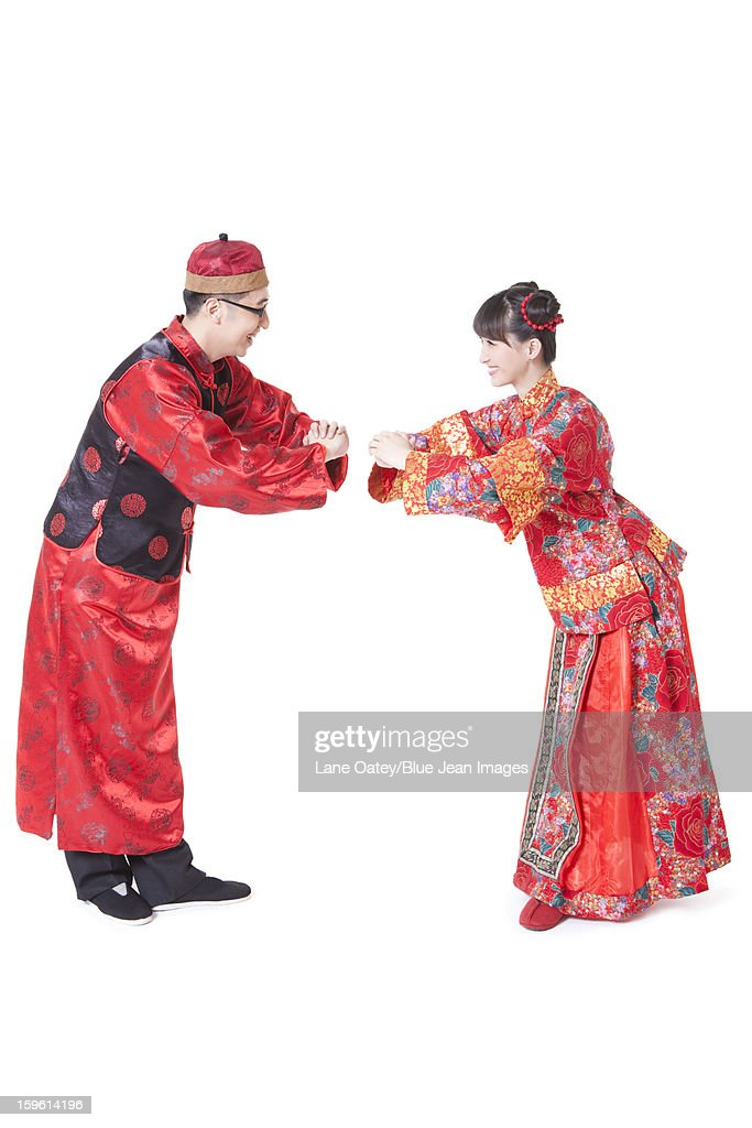 Young couple greeting for chinese new year in traditional chinese young couple greeting for chinese new year in traditional chinese clothing stock photo m4hsunfo