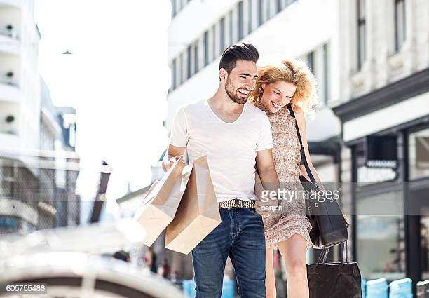 Young Couple Happily Walking the Streets After a Shopping Spree