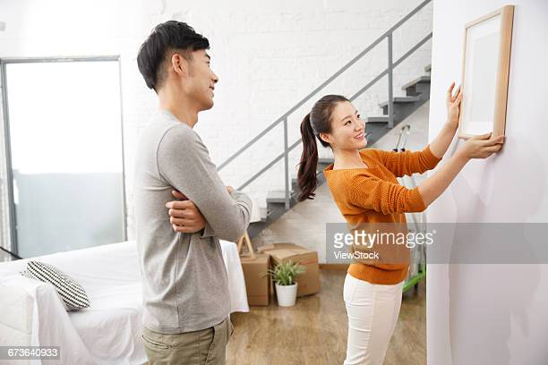 Young couple happy home improvement