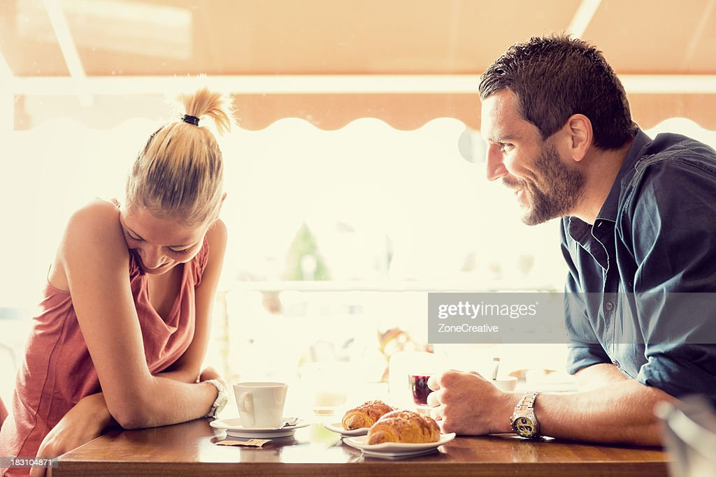 Young couple has breakfast at italian café : Stock Photo