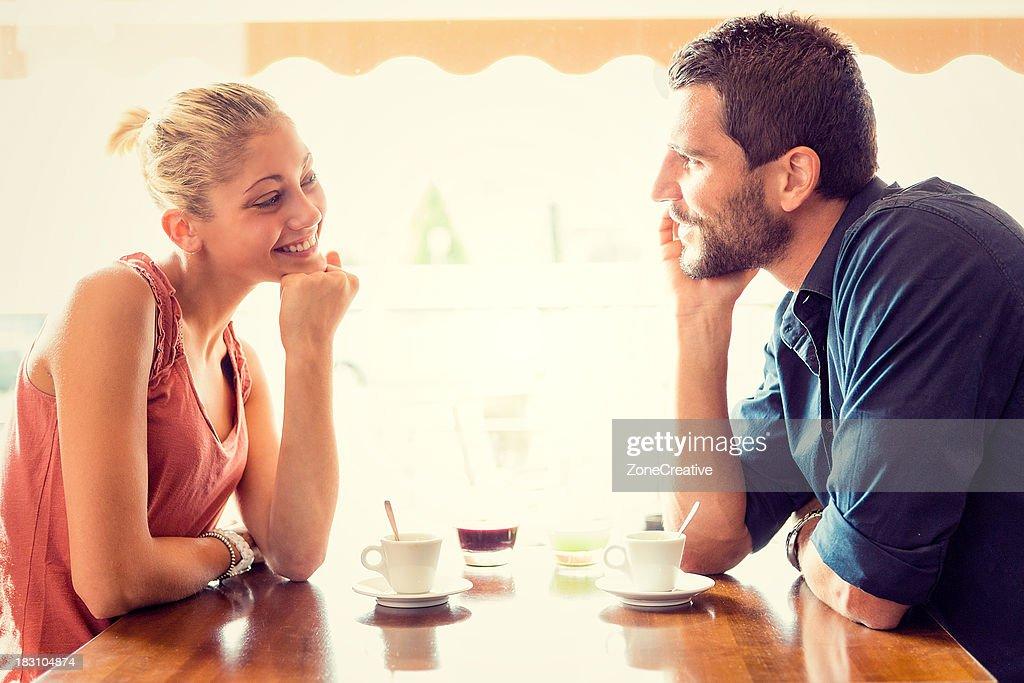 Young couple has breakfast at italian café : Stock Photo