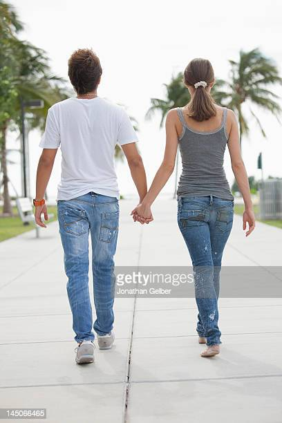 Young couple have s stroll hand in hand