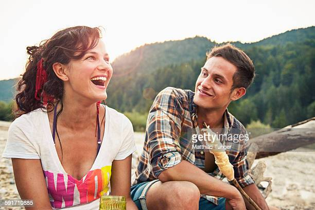 Young couple having a barbecue in the nature
