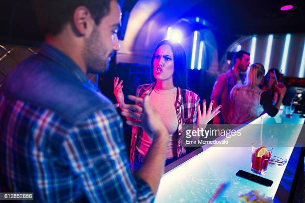 Young couple having a big quarrel in the nightclub