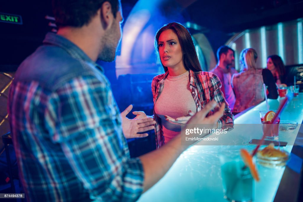 Young couple having a big quarrel in the nightclub : Stock Photo
