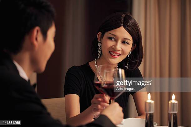 Young couple having a candle lit dinner