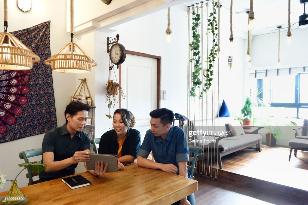 Young couple having a financial consultation at their dining table : Stock Photo