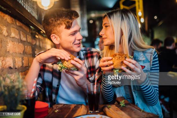 young couple having a meal - girlfriend stock pictures, royalty-free photos & images