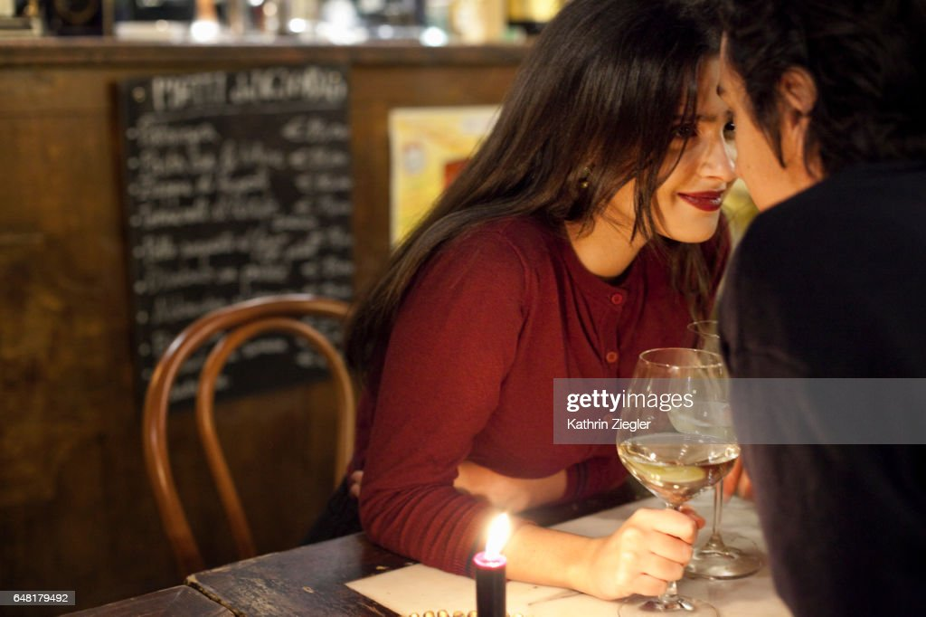 Young couple having a romantic moment at a restaurant, Rome, Italy : Stock Photo