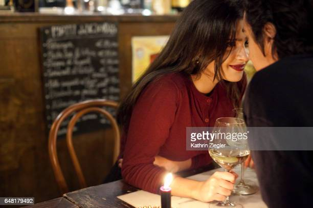 young couple having a romantic moment at a restaurant, rome, italy - dating stock-fotos und bilder