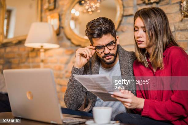 Young couple having bills to pay.