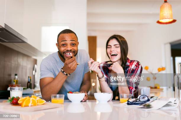 young couple having breakfast in the kitchen - man eating woman out stock photos and pictures