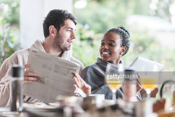 Young couple having breakfast on the terrace