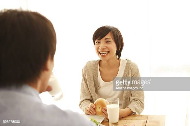 young couple having breakfast - 妻 ストックフォトと画像