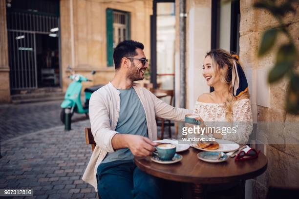 young couple having brunch at traditional cafe in europe - vintage restaurant stock pictures, royalty-free photos & images
