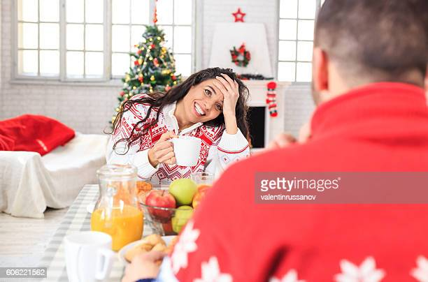 Young couple having christmas breakfast at home