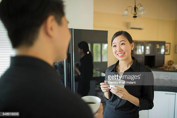young couple having coffee at home - black blouse stock pictures, royalty-free photos & images
