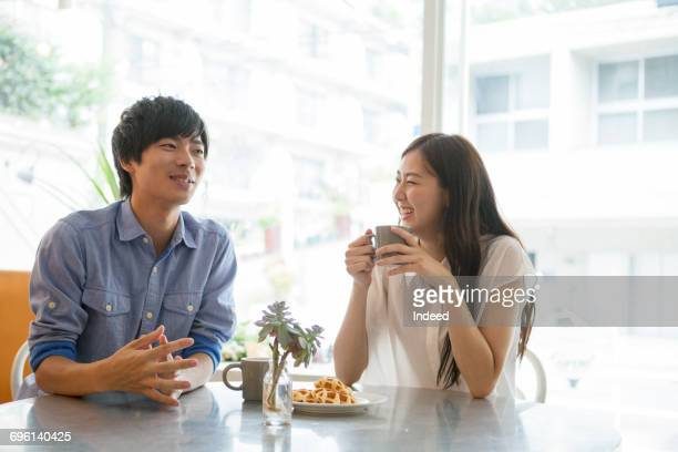Young couple having coffee at table