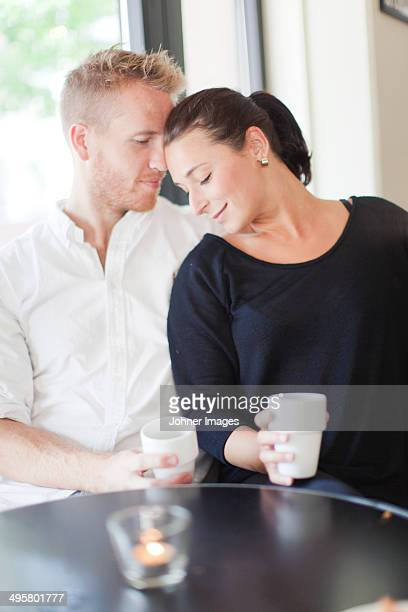 young couple having coffee in cafe, vaxjo, smaland, sweden - vaxjo stock pictures, royalty-free photos & images